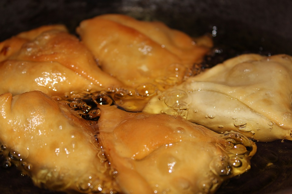 chicken frying in hot oil